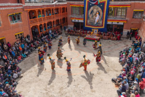 Group of monks performing dancing at the courtyard of Chode monastery