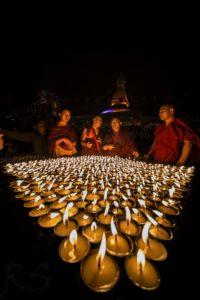 Monks lighting Butter Lamps on the occasion of Budhha Purnima at Bouddha. Photo: Photo Khichuwa