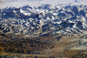 On Nov. 26, 2003, astronauts on board the International Space Station took advantage of their unique vantage point to photograph the Himalayas, looking south from over the Tibetan Plateau. The perspective is illustrated by the summits of Makalu [left (8,462 meters; 27,765 feet)] and Everest [right (8,850 meters; 29,035 feet)] – at the heights typically flown by commercial aircraft. Credit: NASA