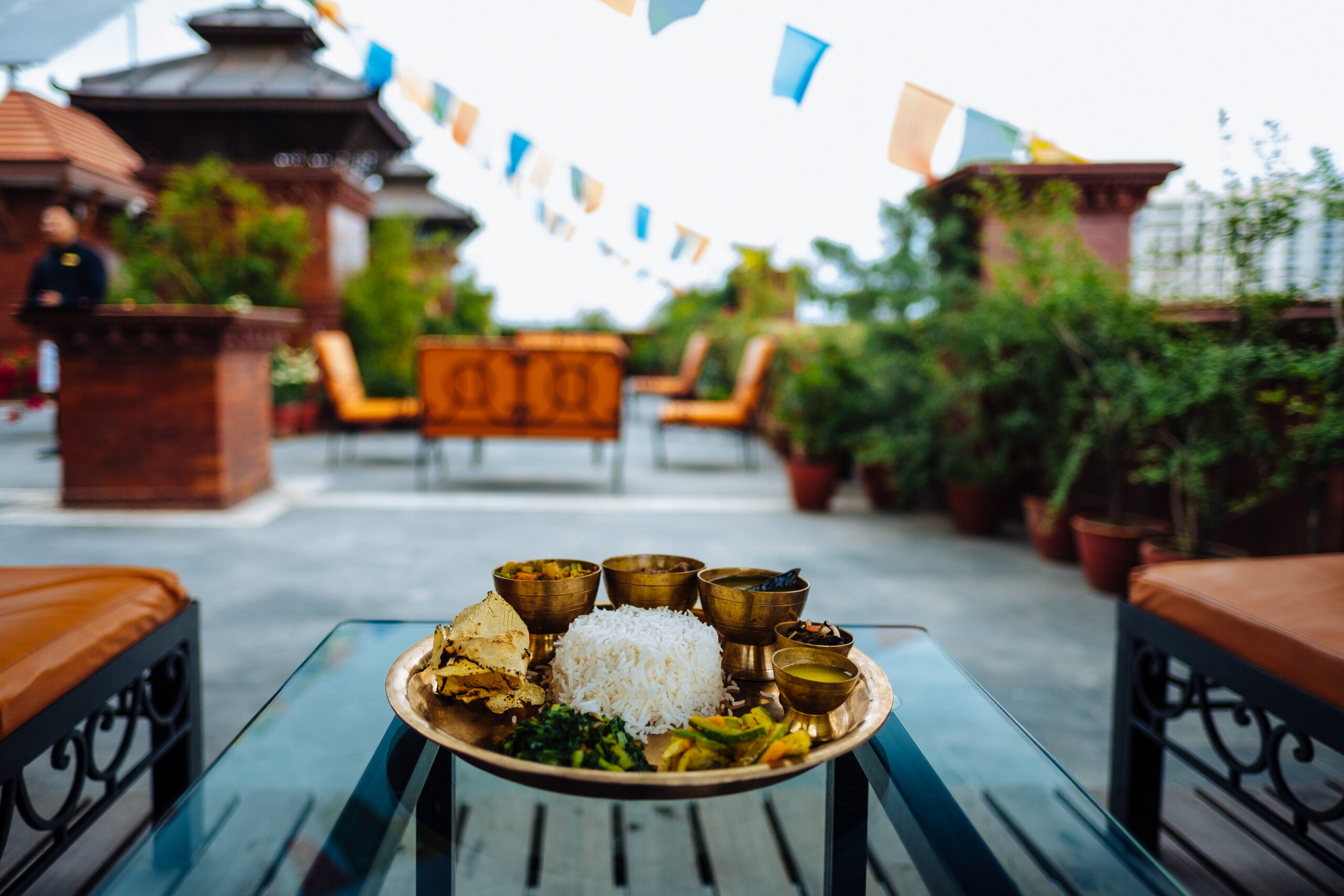 Nepali-Thali-set-at-Rooftop-Terrace-in-Traditional-Comfort